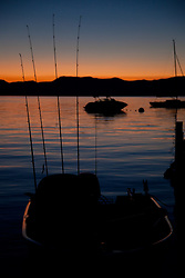 """Tahoe Fishing Boat at Sunrise"" - This silhouette of a fishing boat and fishing poles was photographed at sunrise on Lake Tahoe."