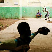 Although the 2008 opening day for Major League Baseball is more than a week away in the United States, play goes on year round in Cuba. In the neighborhood of Havana Vieja (Old Havana) boys take to the streets with bats, balls, sticks, worn gloves and all sorts of makeshift equipment to get their daily fix of the game. ltqmb CUBA: STICKBALL
