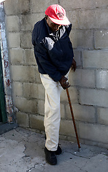 Cape Town-180815-Thozi Mciki (50) one of the people that suffers from the rarest, most disabling genetic conditions known to medicine,Fibrodysplasia ossificans progressiva (FOP) causes bone to form in muscles, tendons, ligaments and other connective tissues. Bridges of extra bone develop across joints, progressively restricting movement and forming a second skeleton that imprisons the body in bone. There are no other known examples in medicine of one normal organ system turning into another.In the picture Thozi makes his way to the toilet that is situated outside his house. Pictures:Brendan Magaar/African News Agency (ANA)