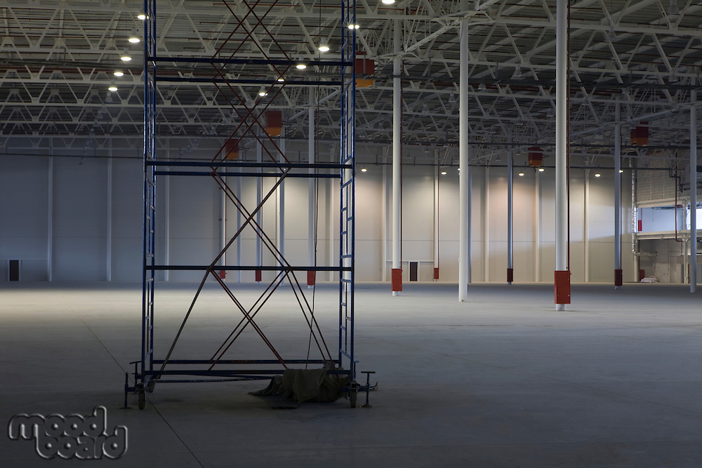 Empty warehouse with scaffold