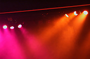 Coloured stage lights and smoke as a vivid colour background