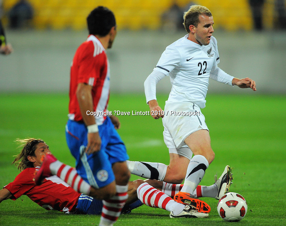 NZ's Jeremy Brockie is tackled. International football friendly - New Zealand All Whites v Paraguay at Westpac Stadium, Wellington on Tuesday, 12 October 2010. Photo: Dave Lintott / photosport.co.nz