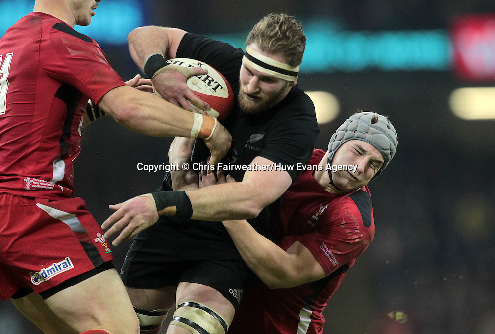 22.11.14 - Wales v New Zealand - Dove Men Series 2014 - Kieran Read of New Zealand is tackled by Jonathan Davies of Wales <br /> <br /> &copy; Huw Evans Picture Agency