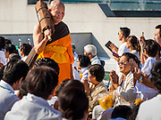 """02 JANUARY 2015 - KHLONG LUANG, PATHUM THANI, THAILAND: Monks leave the meditation hall at Wat Phra Dhammakaya to start the 4th annual Dhammachai Dhutanaga (a dhutanga is a """"wandering"""" and translated as pilgrimage). More than 1,100 monks are participating in a 450 kilometer (280 miles) long pilgrimage, which is going through six provinces in central Thailand. The purpose of the pilgrimage is to pay homage to the Buddha, preserve Buddhist culture, welcome the new year, and """"develop virtuous Buddhist youth leaders."""" Wat Phra Dhammakaya is the largest Buddhist temple in Thailand and the center of the Dhammakaya movement, a Buddhist sect founded in the 1970s.   PHOTO BY JACK KURTZ"""