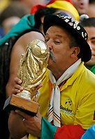 Photo: Glyn Thomas.<br />Brazil v Australia. Group F, FIFA World Cup 2006. 18/06/2006.<br /> A Brazilian fan kisses a replica World Cup trophy.