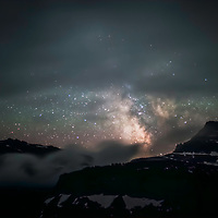 With a break in the clouds the Milky Way magically appears to be like a star gate!