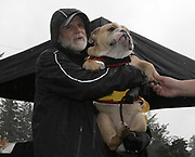 Dec 2, 2017; Portland, OR, USA; Manlius coach Bill Aris holds a bulldog during the 2017 Nike Cross Nationals at Glendoveer Golf Course.