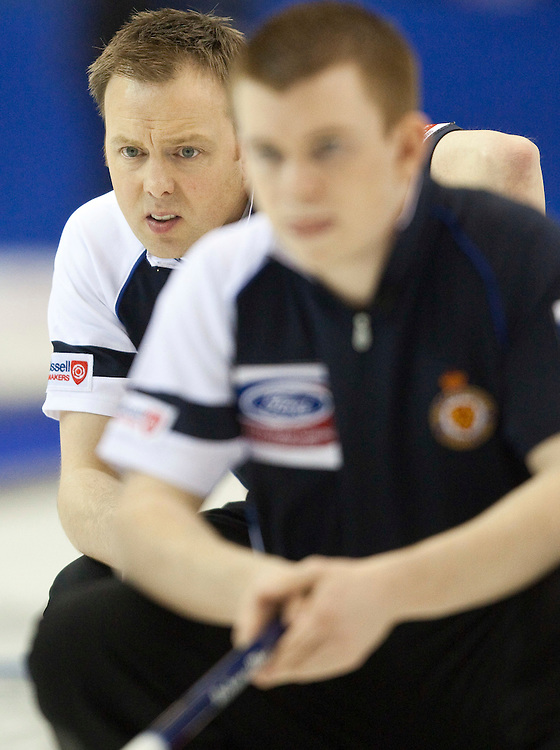 Scottish skip Tom Brewster, left, and third Greg Drummond strategize during their semi-final against Norway at the Ford World Men's Curling Championships in Regina, Saskatchewan, April 9, 2011.<br /> AFP PHOTO/Geoff Robins