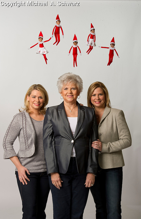 12/15/10 1:07:10 -- Marietta, , GA<br /> <br /> Carole Aebersold with her daughters, Chanda Bell, left and Christa Pitt, right, with elves.<br />  -- Carole Aebersold and her daughter Chanda Bell wrote a children's book, &quot;The Elf on the Shelf&quot; a few years ago. It was turned down by all the major publishing houses. It is now NO. 3 on USA Today's Bestselling Bookslist. It's a phenomenon. Chanda's twin sister Christa Pitt is a co-CEO in the company. -- <br /> <br /> <br /> Photo by Michael  A. Schwarz, USA TODAY contract photographer