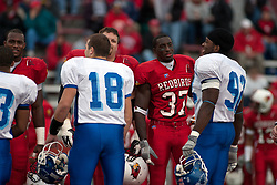 12 November 2005: Captains from both teams meet, greet and have a good time before the coin toss.  Illinois State Redbirds topple the Indiana State Sycamore 70-28 at Hancock Stadium in Normal Illinois