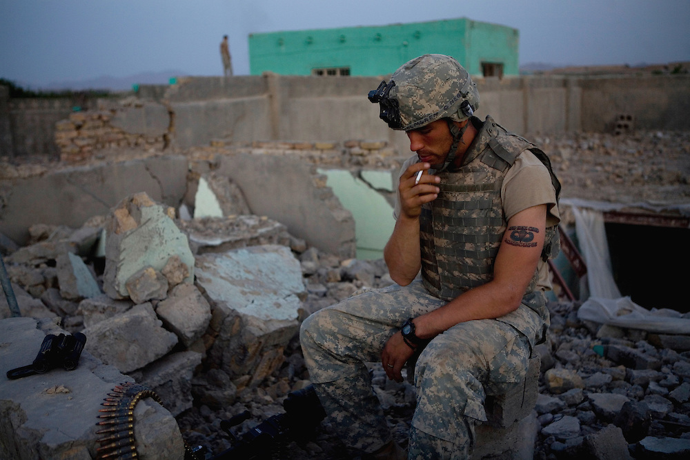 Specialist Adam Holmgren of the 82nd Airborne's 1/508, Alpha Company, Third Platoon stands on guard duty in Sangin, Helmand province, Afghanistan on Monday, April 9, 2007.