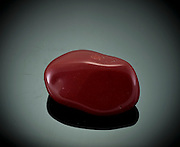 Cutout of a Red Jasper gemstone on black background