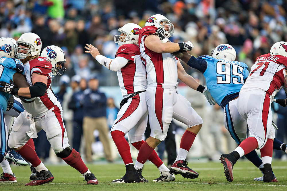 NASHVILLE, TN - DECEMBER 15:  Carson Palmer #3 of the Arizona Cardinals has his own lineman blocked into his back while trying to throw a pass during a game against the Tennessee Titans at LP Field on December 15, 2013 in Nashville, Tennessee.  The Cardinals defeated the Titans 37-34.  (Photo by Wesley Hitt/Getty Images) *** Local Caption *** Carson Palmer