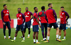 England's Raheem Sterling looks on with team mates - Mandatory by-line: Matt McNulty/JMP - 29/08/2017 - FOOTBALL - St George's Park National Football Centre - Burton-upon-Trent, England - England Training and Press Conference