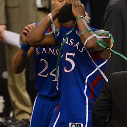 Apr 2, 2012; New Orleans, LA, USA; Kansas Jayhawks guard Elijah Johnson (15) and guard Travis Releford (24) walk off the court after losing to the Kentucky Wildcats 67-59 in the finals of the 2012 NCAA men's basketball Final Four at the Mercedes-Benz Superdome. Mandatory Credit: Derick E. Hingle-US PRESSWIRE