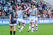 Manchester City Women midfielder Keira Walsh (24) scores a goal and celebrates with team mates to make the score 1-0 during the FA Women's Super League match between Manchester City Women and BIrmingham City Women at the Sport City Academy Stadium, Manchester, United Kingdom on 12 October 2019.