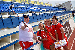 MARBELLA, SPAIN - Tuesday, March 5, 2019: Wales' Natasha Harding, Jessica Fishlock, Loren Dykes and Angharad James pose for a selfie with a supporter after an international friendly match between Wales and Republic of Ireland at the Estadio Municipal de Marbella. (Pic by David Rawcliffe/Propaganda)