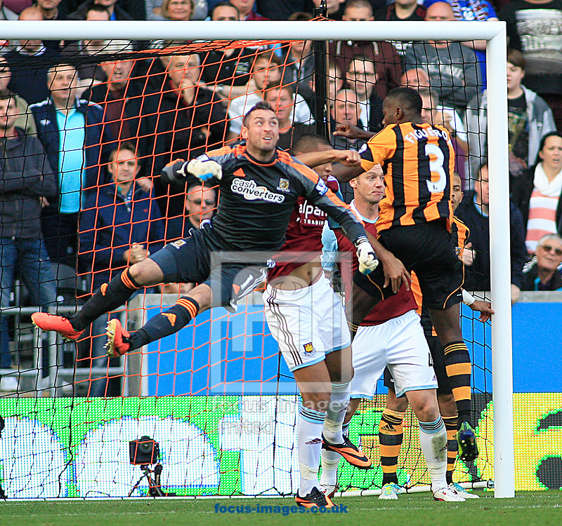 Picture by Richard Gould/Focus Images Ltd +44 7855 403186<br /> 28/09/2013<br /> Allan McGregor (left) of Hull City punches the ball clear during the Barclays Premier League match at the KC Stadium, Kingston upon Hull.
