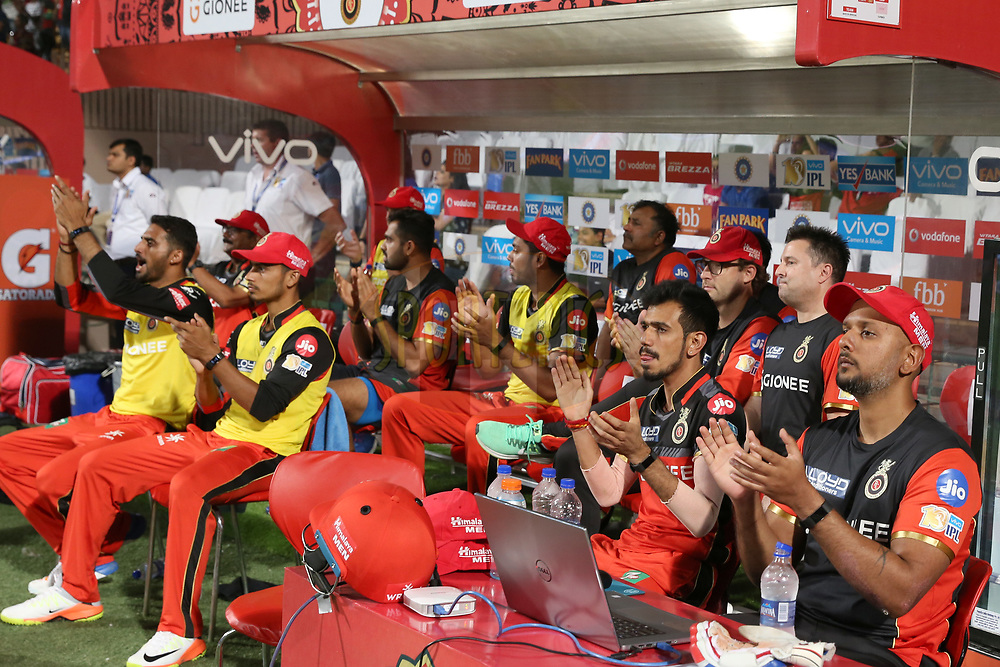 Royal Challengers Bangalore players in dugout celebrating the wicket of Delhi Daredevils during match 5 of the Vivo 2017 Indian Premier League between the Royal Challengers Bangalore and the Delhi Daredevils held at the M.Chinnaswamy Stadium in Bangalore, India on the 8th April 2017<br /> <br /> Photo by Faheem Hussain - IPL - Sportzpics