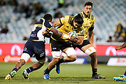 Michael Fatialofa takes on the defence during the Super Rugby match, Brumbies V Hurricanes, GIO Stadium, Canberra, Australia, 30th June 2018.Copyright photo: David Neilson / www.photosport.nz