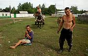 Drunken villagers loiter in the Chodura village in the Tuva Republic, southern Siberia, Russia. Alcoholism is rife in the region.