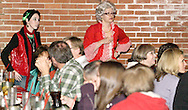 """Krystal Claus (left, standing, aka Alisha McDarris) and Mrs. Claus (aka Tamra Francis of Dayton) during Mayhem & Mystery's production of """"I'll Be Home Shopping for Christmas"""" at the Spaghetti Warehouse in downtown Dayton, Monday, November 9, 2009."""