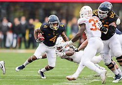 Nov 18, 2017; Morgantown, WV, USA; West Virginia Mountaineers running back Kennedy McKoy (4) runs the ball during the third quarter against the Texas Longhorns at Milan Puskar Stadium. Mandatory Credit: Ben Queen-USA TODAY Sports