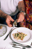 October 1992, Feisoglio, Italy --- Diner Shaving White Truffles over Pasta at Ristorante de Renato --- Image by © Owen Franken/CORBIS