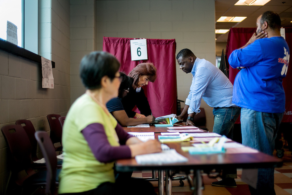 FORT LEE, NJ - JUNE 7, 2016: Voters speak to poll workers before casting their ballots at the Fort Lee Community Center in Fort Lee, New Jersey. CREDIT: Sam Hodgson for The New York Times.