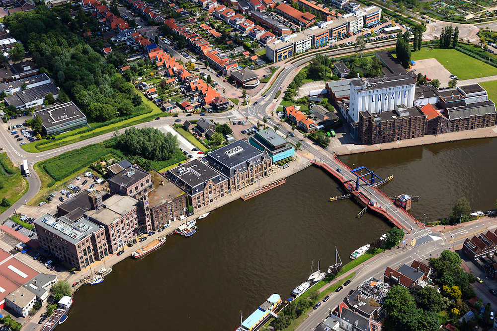 Nederland, Noord-Holland, Zaanstad, 14-06-2012; Wormerveer, rivier de Zaan met de gerenoveerde Lassie fabriek en andere industriele monumenten aan de Veerdijk in Wormer..Rice producing factory Lassie and other renovated industrial monuments on the river Zaan in Wormer..luchtfoto (toeslag), aerial photo (additional fee required).foto/photo Siebe Swart