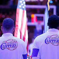 17 October 2014: Los Angeles Clippers forward Blake Griffin (32) and Los Angeles Clippers center DeAndre Jordan (6) stand during national anthem prior to the Los Angeles Clippers 101-97 victory over the Utah Jazz, in a preseason game, at the Staples Center, Los Angeles, California, USA.