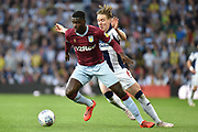 Aston Villa defender (on loan from Manchester United) Axel Tuanzebe (4) battles for possession  withWest Bromwich Albion midfielder (on loan from Fulham) Stefan Johansen (6) during the EFL Sky Bet Championship play-off second leg match between West Bromwich Albion and Aston Villa at The Hawthorns, West Bromwich, England on 14 May 2019.
