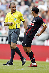 Bayern Munich v FC Koln.  Lutz Wagner shows off his dance moves to the referee.