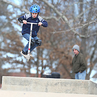 Lauren Wood | Buy at photos.djournal.com<br /> Nathan Williams, 8, of Corinth, does a jump on his scooter while riding Monday afternoon at the skatepark at Ballard Park. Nathan was at the park with his father Frank, background, and they were testing differences between riding a scooter and riding a skateboard for a science project of Nathan's.