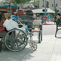 A homeless man sleeps while sitting on a bench on Santa monica Blvd on Friday, July20, 2007.
