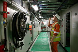 Final preparations are made below deck ahead of sea trials this summer, for the Royal Navy's new aircraft carrier HMS Queen Elizabeth, at Rosyth Dockyard in Dunfermline.