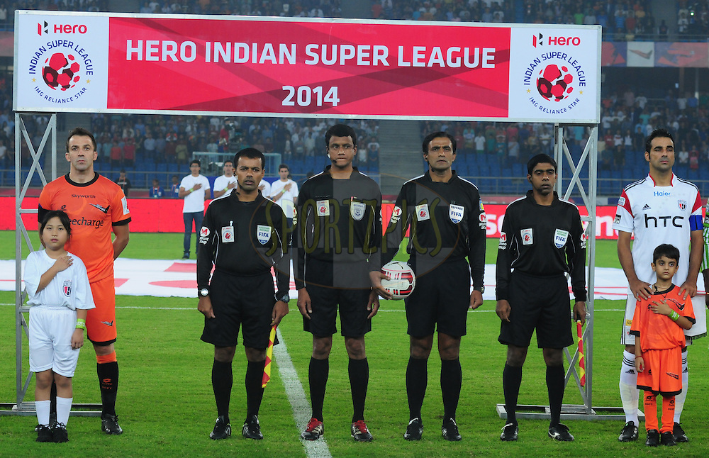 Delhi Dynamos alessandro del Piero,match referee and NorthEast United FC captain Miguel Garcia  line up for the national anthem during match 16 of the Hero Indian Super League between The Delhi Dynamos FC and NorthEast United FC held at the Jawaharlal Nehru Stadium, Delhi, India on the 29th October 2014.<br /> <br /> Photo by:  Arjun Panwar/ ISL/ SPORTZPICS
