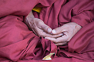Hands of a meditating monk.