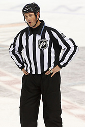Jan 17, 2012; San Jose, CA, USA; NHL linesman Scott Driscoll (68) during a stoppage in play during the second period between the San Jose Sharks and the Calgary Flames at HP Pavilion. San Jose defeated Calgary 2-1 in shootouts. Mandatory Credit: Jason O. Watson-US PRESSWIRE