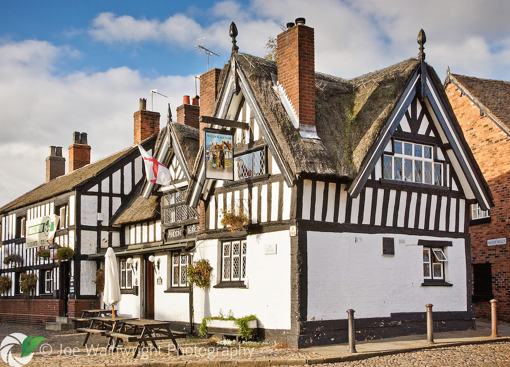 Ye Olde Black Bear Inn, located at the entrance to the cobbled market square in Sandbach, Cheshire, dates from 1634.