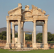 Tetrapylon or monumental gateway, 2nd century AD, Aphrodisias, Aydin, Turkey. The tetrapylon greeted pilgrims visiting the Temple or Sanctuary of Aphrodite and linked the main North-South street of the town to the Sacred Way leading to a large forecourt in front of the temple. It consists of 4 rows of 4 columns and the pediment over the West columns is decorated with reliefs of Eros and Nike hunting among the acanthus leaves. Aphrodisias was a small ancient Greek city in Caria near the modern-day town of Geyre. It was named after Aphrodite, the Greek goddess of love, who had here her unique cult image, the Aphrodite of Aphrodisias. The city suffered major earthquakes in the 4th and 7th centuries which destroyed most of the ancient structures. Picture by Manuel Cohen
