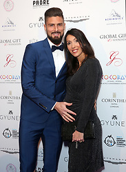 Olivier Giroud and Jennifer Giroud attending the Global Gift Gala held at The Corinthia Hotel in London.