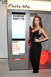 """OLIVIA GRANT at the launch of """"Photo-Me by Starck"""" – a photobooth exclusively designed by the world renowned artist and creator Philippe Starck held at The Saatchi Gallery, Duke Of York Square, Kings Road, London on 2nd November 2011."""