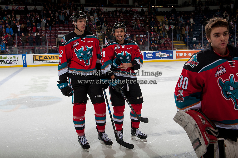 KELOWNA, CANADA - NOVEMBER 10: Braydyn Chizen #22 and Carsen Twarynski #18 of the Kelowna Rockets stand on the ice after winning the game against the Vancouver Giants in OT on November 10, 2017 at Prospera Place in Kelowna, British Columbia, Canada.  (Photo by Marissa Baecker/Shoot the Breeze)  *** Local Caption ***