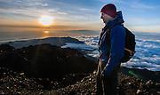 Hiker on top of Mount Rinjani at dawn (Lombok, Indonesia)