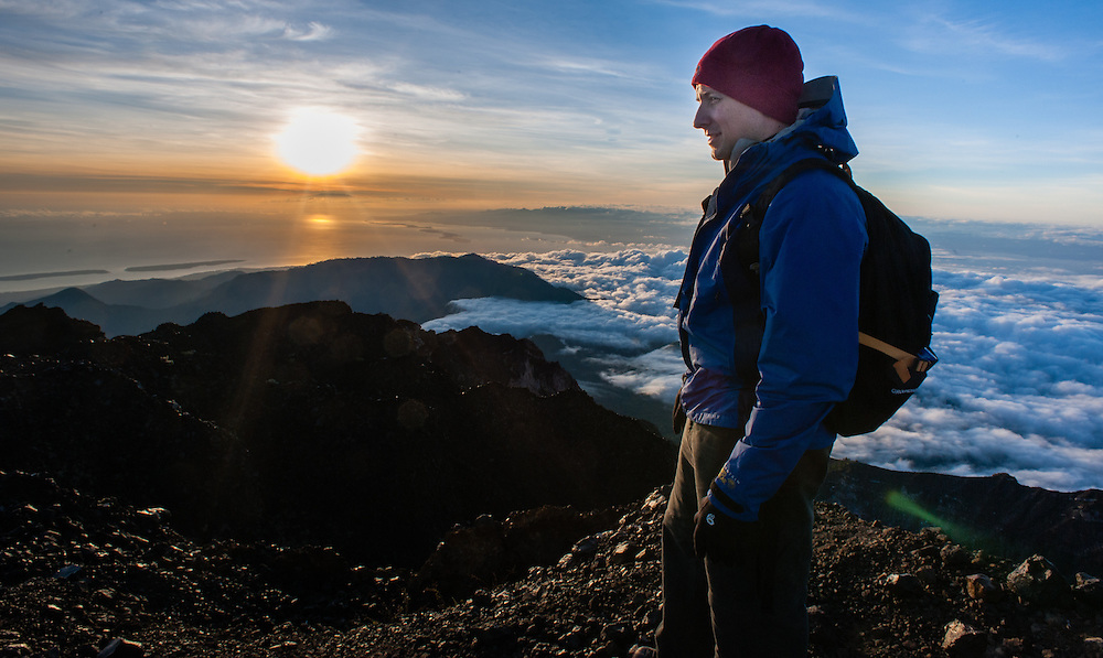 Hiker on top of Mount Rinjani at dawn (Lombok, Indonesia)