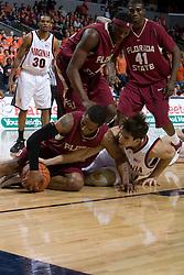 Florida State Seminoles guard Isaiah Swann (3) battles for a loose ball with Virginia Cavaliers forward/center Ryan Pettinella (34).  The Virginia Cavaliers Men's Basketball Team defeated the Florida State Seminoles 73-70 at the John Paul Jones Arena in Charlottesville, VA on February 17, 2007.