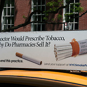 "Public Service Anti-Smoking Advertisement  on top of cab ""No Doctor Would Prescribe Tobacco, So Why Do Pharmacies Sell It? It's time to end this practice"""