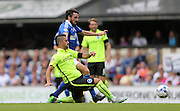 Brighton central midfielder, Beram Kayal slide tackles during the Sky Bet Championship match between Ipswich Town and Brighton and Hove Albion at Portman Road, Ipswich, England on 29 August 2015.