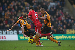 WOLVERHAMPTON, ENGLAND - Saturday, January 22, 2011: Liverpool's Fernando Torres is tackled by Wolverhampton Wanderers' Richard Stearman during the Premiership match at Molineux. (Photo by David Rawcliffe/Propaganda)